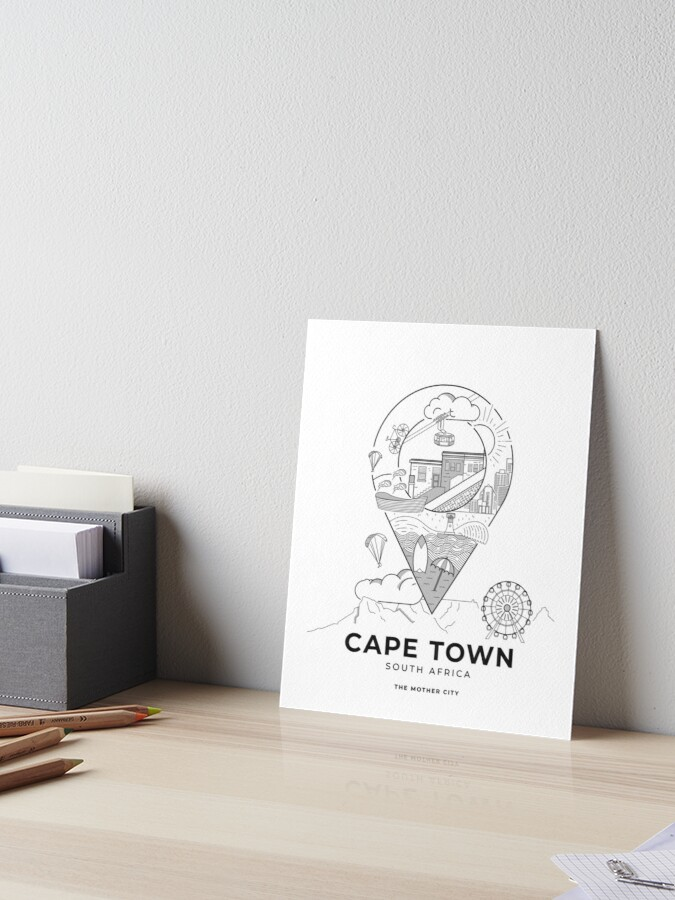 Photo of an art board print featuring a vector-illustrated Cape Town travel poster.