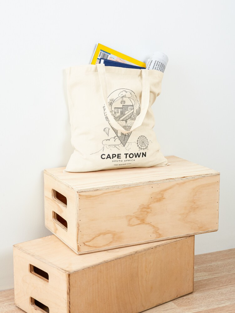 Photo of a cotton totebag featuring a vector-illustrated Cape Town travel poster.