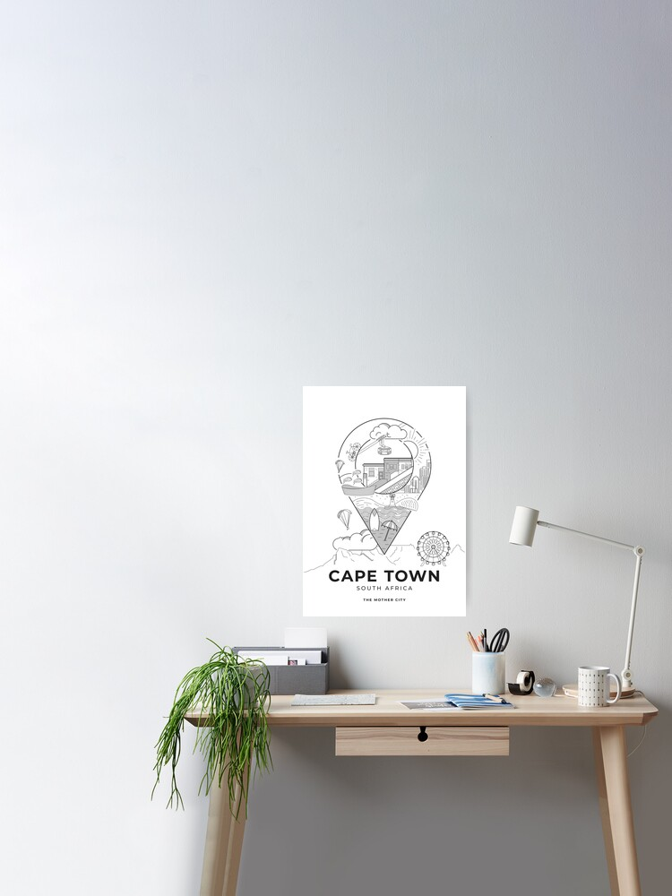 Photo of a vector-illustrated Cape Town travel poster hanging above a work desk.